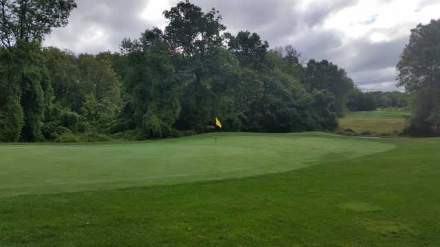 A cloudy day view of a hole at Raritan Landing Golf Course.