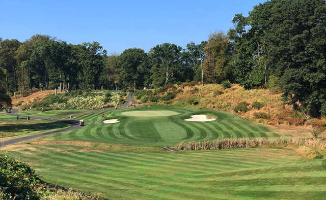 A view of a green flanked by bunkers at Galloping Hill Golf Course.