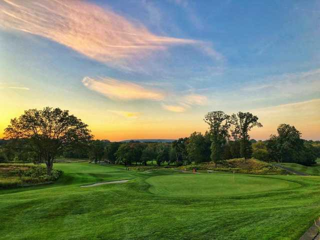 A sunset view of a hole at Galloping Hill Golf Course.