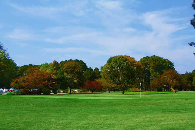 A fall day view of a green at Green Hill Country Club.