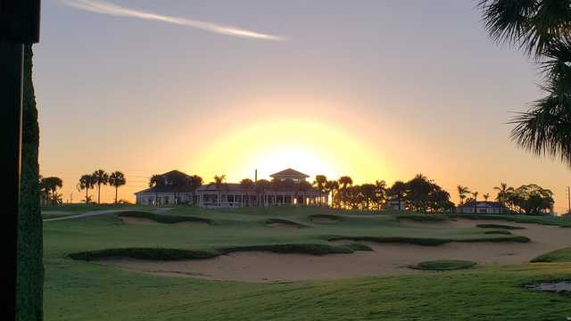 A fantastic sunrise view of the clubhouse and a green at North Palm Beach Country Club.
