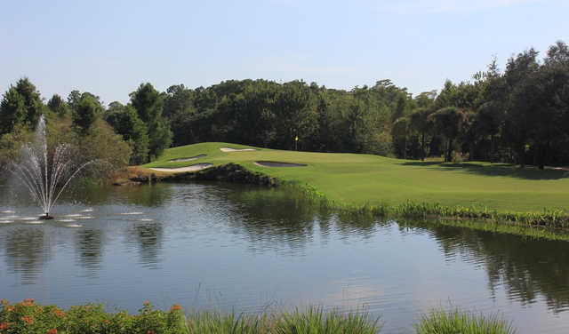 A view of a green with water and bunkers coming into play at Cypress Woods Golf & Country Club.