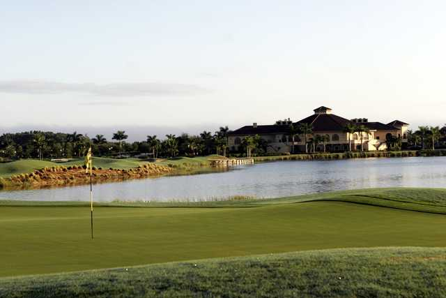 A view of a green and the clubhouse in background at Heritage Bay Golf and Country Club.