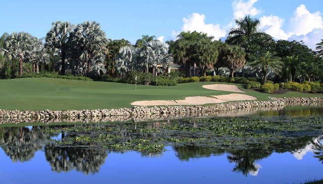 A view of a green with water and bunkers coming into play at Boca Grove Golf & Tennis Club.