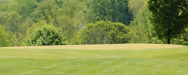 A sunny day view of a hole at Delaware Golf Club.