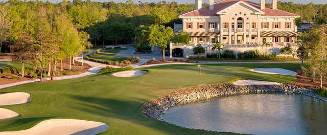 A view of a hole and the clubhouse at Naples National Golf Club.