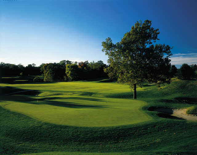 A sunny day view of a green at Annbriar Golf Course.