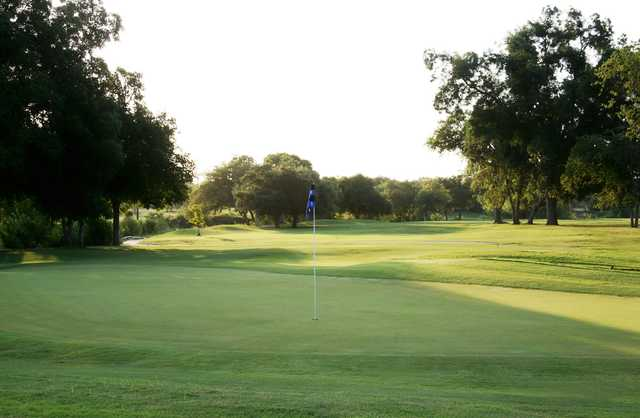 A sunny day view of a hole at Duck Creek Golf Course.