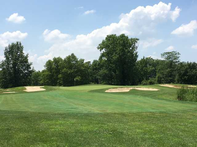 A view of a green flanked by bunkers at Foxfire Golf Club.