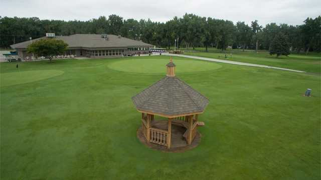 View of the clubhouse and putting green at Miles City Town & Country Club.