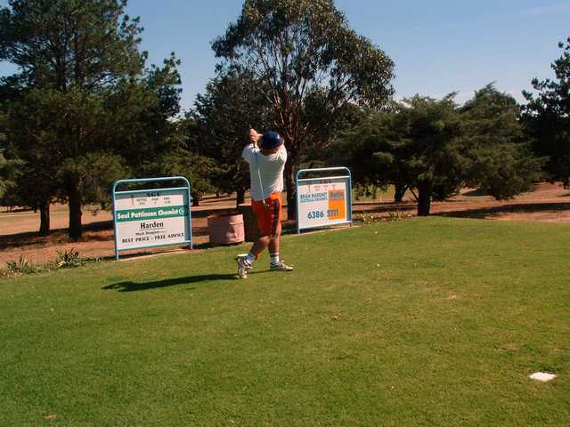 Golfer teeing off at Harden Country Club