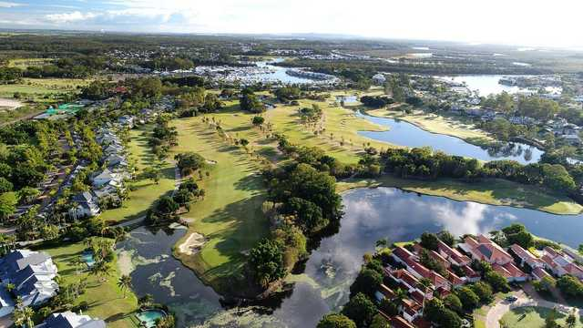 Aerial view of the 8th green on the left, the 7th in the middle and 6th on the right at The Palms Sanctuary Cove Resort.