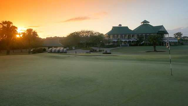 Sunrise over Palmer Colonial's clubhouse