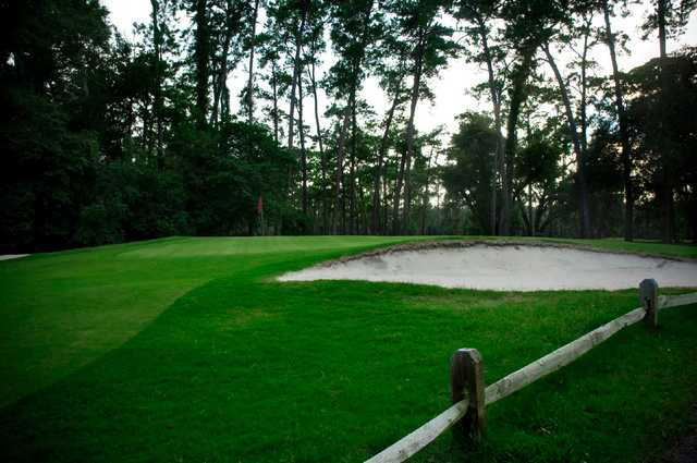 A view of a hole protected by sand traps at Hyde Park Golf Club