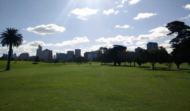 A sunny day view of a hole at Albert Park Golf Course.