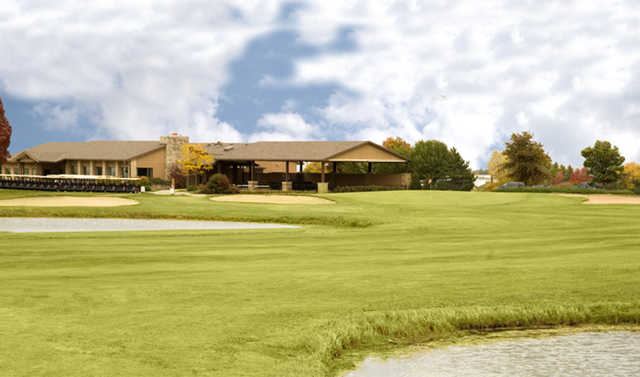 A view of a green and the clubhouse at Ives Grove Golf Links.