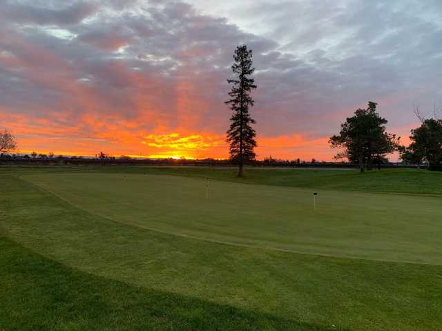 A sunset view of the practice putting green at Micke Grove Golf Links.