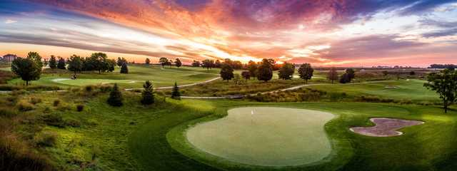 A sunset view of a hole at Otter Creek Golf Course.