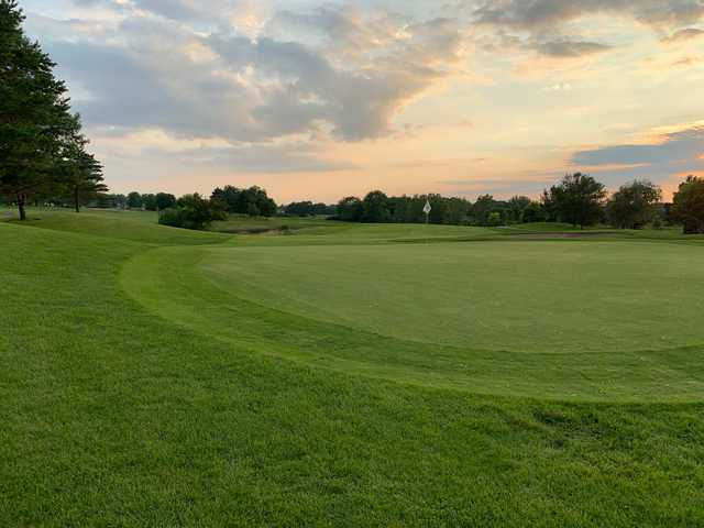 A sunset view of a hole at Crystal Lake Golf Club.