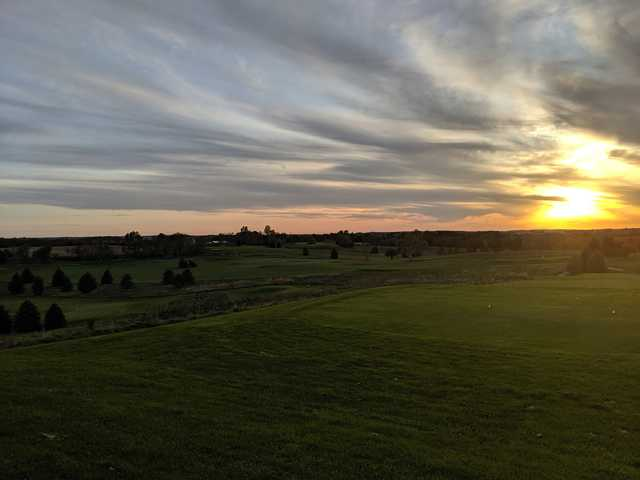 A sunset view of a tee at Gopher Hills Golf Course.