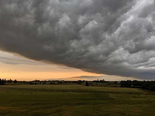 A view of the driving range covered by dark clouds at Gopher Hills Golf Course.