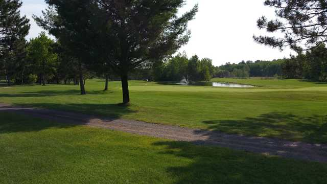A sunny day view of a green at Gordon Pines Golf Club.