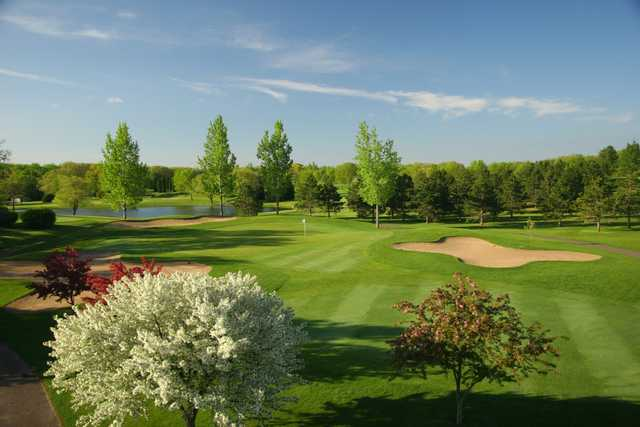 A spring day view of a hole at Pebble Creek Country Club.