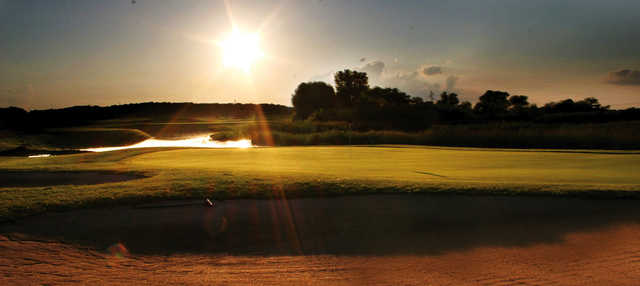 A sunny day view of a green at Wedgewood Cove Golf Club.