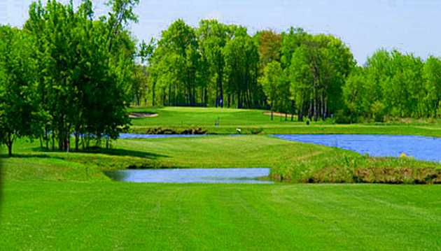 A view of hole #1 at Blue Golf Course from The Ponds Golf Club.