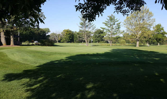 A sunny day view of a hole at Woodland Hills Golf Course.