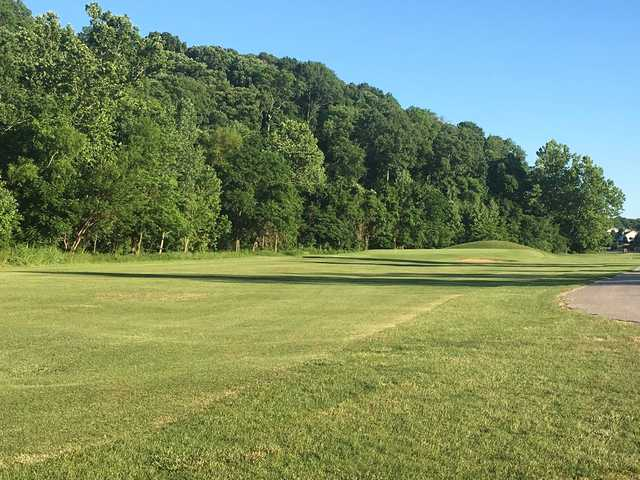 A sunny day view of a green at Sugar Creek Golf Course.
