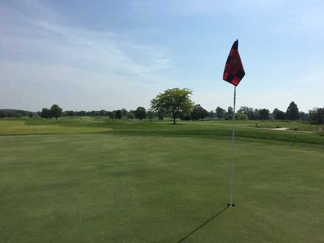 A sunny day view of a hole at Crown Pointe Golf Club.
