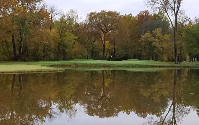 A fall day view of a hole at Fox Creek Golf Club.