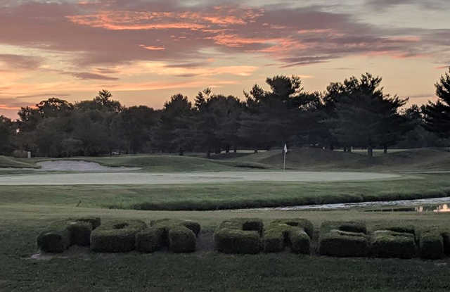 A sunset view of a hole at Fox Creek Golf Club.
