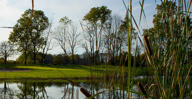 A view of a green with water coming into play at Wood Wind Golf Club.