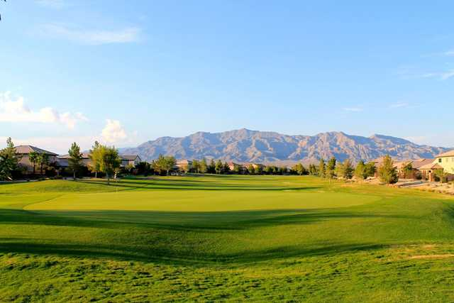 A sunny day view of a green at Aliante Golf Course.