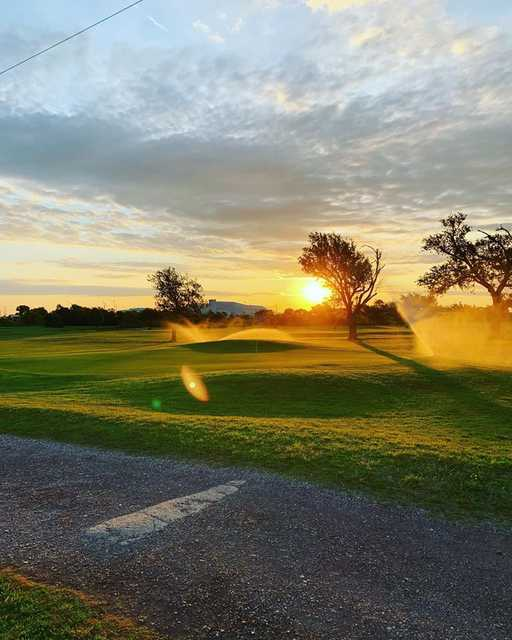 Sunset view of hole #7 at The Greens of Altus Golf Course.