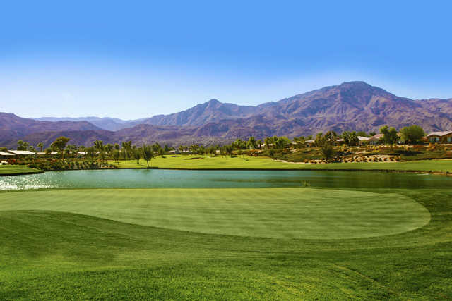 A view of a green with water coming into play at Coral Mountain Golf Club.