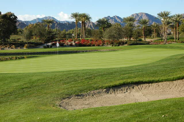 A sunny day view of a hole at Coral Mountain Golf Club.