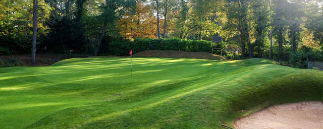 A fall day view of a hole at Camberley Heath Golf Club.