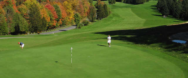 A fall day view of a green at Montgomery Bell State Park Golf Course.