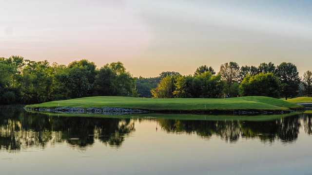 A view of a green surrounded by water at Franklin Bridge Golf Club.