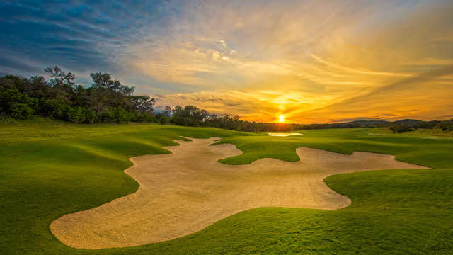 A sunset view of green #8 at Kissing Tree Golf Club.