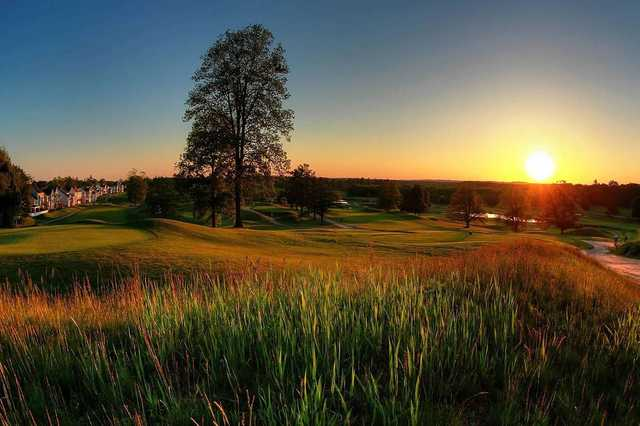 A sunset view of a tee at Merrimack Valley Golf Club.