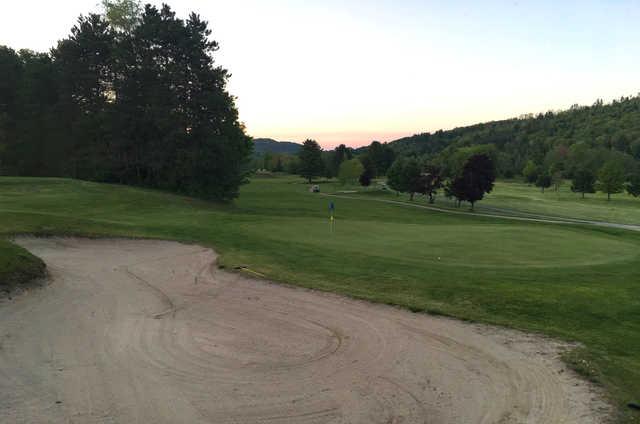 An evening view of a green at Newport Golf Club.