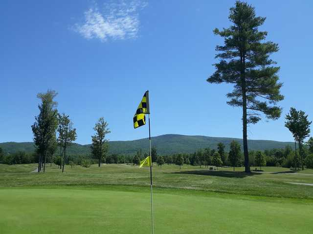 A sunny day view from a green at Ridgewood Country Club.