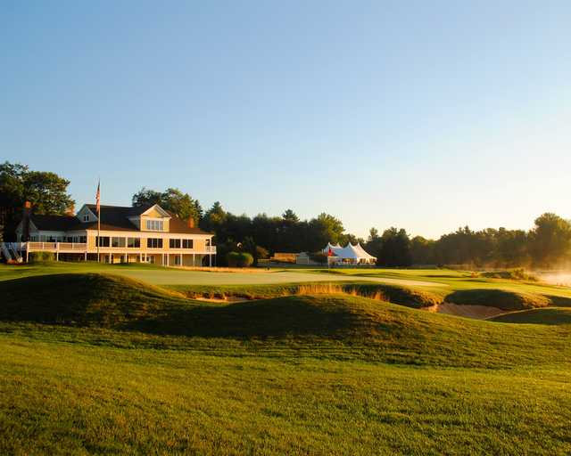 A view of the clubhouse and a well protected green at Falmouth Country Club.