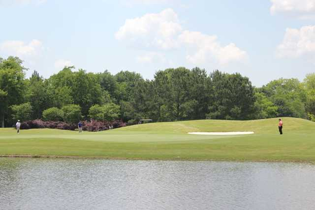 A view of a green with water coming into play at Farm d'Allie Golf Club.