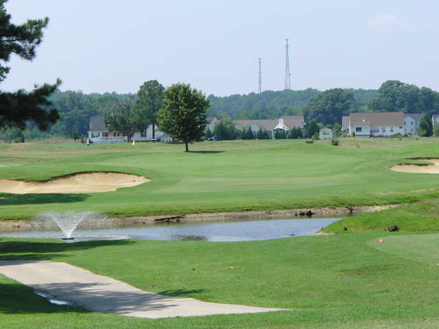 A sunny day view of a green at Hobbs Hole Golf Course.