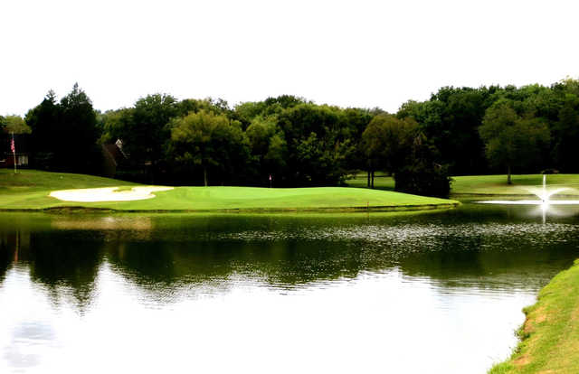 A view of a green surrounded by water at Temple Hills Country Club.
